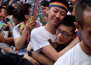 Gay-rights activists hug in celebration at the news that Taiwan's top court ruled in favor of same-sex marriage.