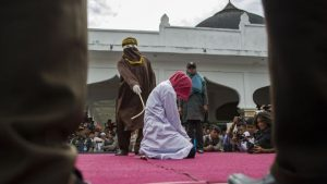 A woman being caned in public in Indonesia. In September 2018, two Malaysian women were caned for attempting to have lesbian sex in a car.