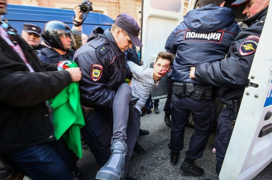 Police in St. Petersburg, Russia, arrest a man who was protesting the treatment of gay men in Chechnya.