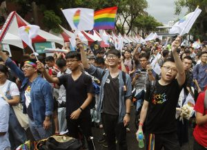 Same-sex marriage supporters jubilantly wave rainbow Taiwan flags after the historic court ruling in 2017.