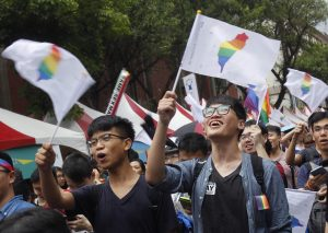 Taiwanese supporters of same-sex marriage celebrate the historic court ruling.