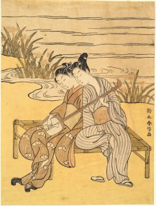 Two Lovers Playing a Single Shamisen, 1766-1769. Color Woodblock print. Suzuki Harnobu (1725-1770).
