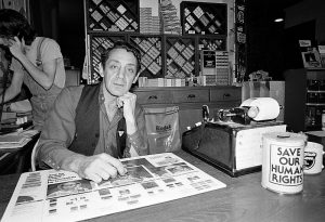Harvey Milk,the first openly gay elected official in California, in Castro Camera, the shop that served as his political headquarters.
