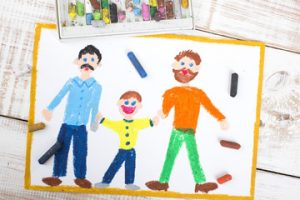 A child's drawing of him and his two gay dads.