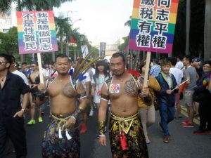 """Two marchers in Taiwan's 11th LGBT Pride march. Their signs read """"I'm proud to be gay; I'm not a sex refugee!"""""""