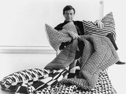 Gernreich with the mod pillows and quilts he designed for Knoll, 1972.